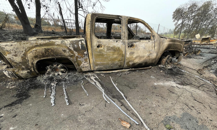 The melted metal from a pickup truck's rims ran down the driveway of this Chicago Park home after the River Fire burned through here, on Aug. 7, 2021. (Elias Funez/The Union via AP)