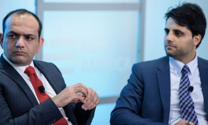 Ameen Habibi (R), Afghan deputy finance minister for policy, and Khalid Payenda, senior adviser to the Afghan minister of finance, are seen in Washington on April 15, 2016. (Brendan Smialowski/AFP via Getty Images)