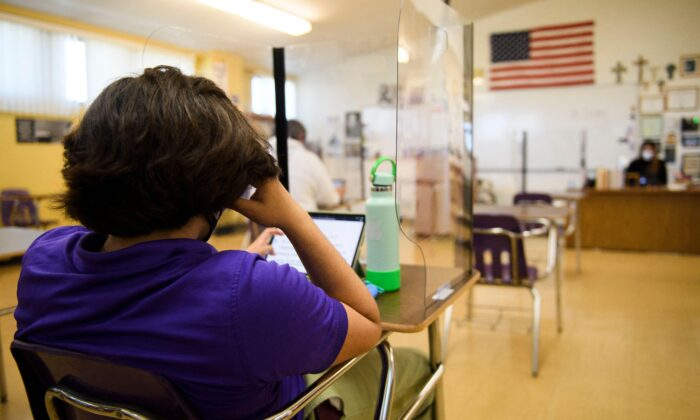 A student at a school in California on March 24, 2021. (Patrick T. Fallon/AFP via Getty Images)