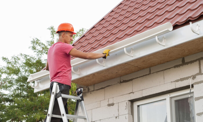 You can typically save about 50 percent of the total cost by installing the gutters yourself. (Shutterstock)