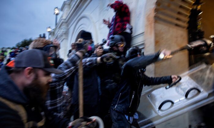 A crowd clashes with law enforcement officers at the U.S. Capitol in Washington on Jan. 6, 2021. (Brent Stirton/Getty Images)