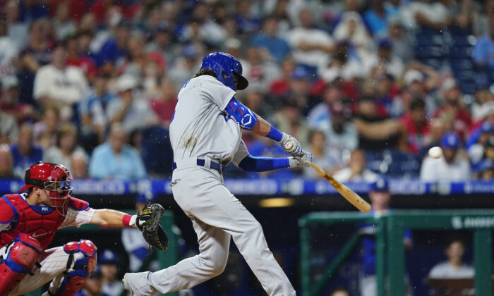 Los Angeles Dodgers' Cody Bellinger hits a two-run home run off Philadelphia Phillies pitcher Kyle Gibson during the fourth inning of a baseball game in Philadelphia on Aug. 11, 2021. (AP Photo/Matt Slocum)