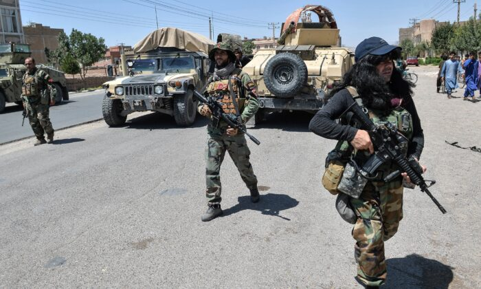 Afghan National Army commando forces walk along a road amid ongoing fighting between Taliban and Afghan security forces in the Enjil district of Herat province, on Aug. 1, 2021.  (Hoshang Hashimi/AFP via Getty Images)