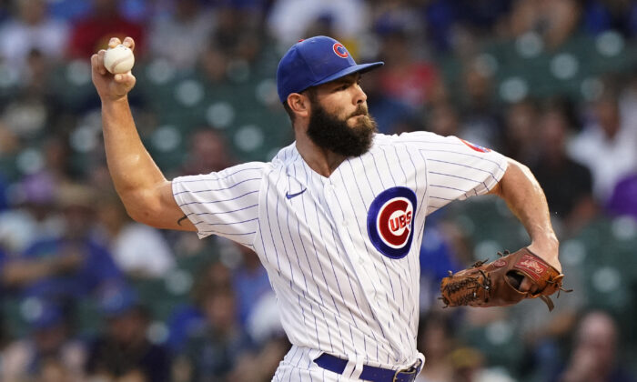 Chicago Cubs starting pitcher Jake Arrieta throws to a Milwaukee Brewers batter during the first inning of a baseball game in Chicago, Ill., on Aug. 11, 2021. (Nam Y. Huh/AP Photo)
