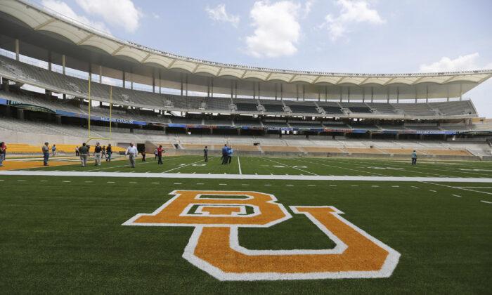 The Baylor University logo is displayed on the football field at McLane Stadium in Waco, Texas, on Aug. 18, 2014. (Waco Tribune-Herald via AP/AP Photo)