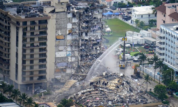 Rescue personnel work at the remains of the Champlain Towers South condo building in Surfside, Fla., on June 25, 2021. (Gerald Herbert/AP Photo)