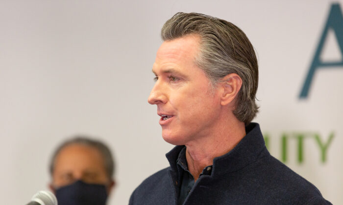 Governor Gavin Newsom speaks to reporters at AltaMed Urgent Care in Santa Ana, Calif., on March 25, 2021. (John Fredricks/The Epoch Times)