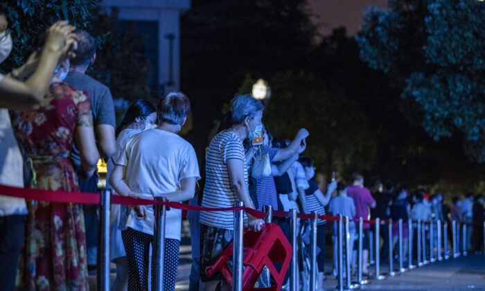 Residents queueing to test for the COVID-19 in Wuhan in China's central Hubei province on Aug. 3, 2021. (STR/AFP via Getty Images)