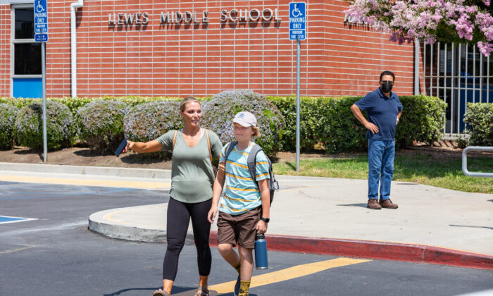 Emily Nelson picks her son Ezra up from the Hewes Middle School principal's office in Santa Ana, Calif., on Aug. 2, 2021. (John Fredricks/The Epoch Times)