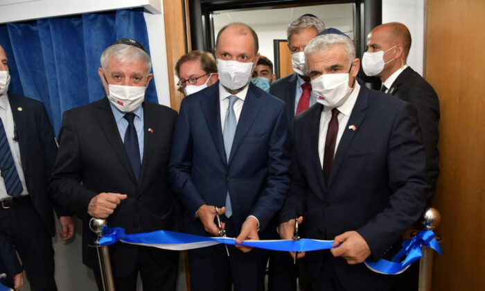 Israeli Foreign Minister Yair Lapid inaugurates Israel's diplomatic mission, in the presence of Minister Delegate to the Moroccan Foreign Ministry Mohcine Jazouli, in Rabat, Morocco, on Aug. 12, 2021. (Israel Ministry of Foreign Affairs/Handout via Reuters)