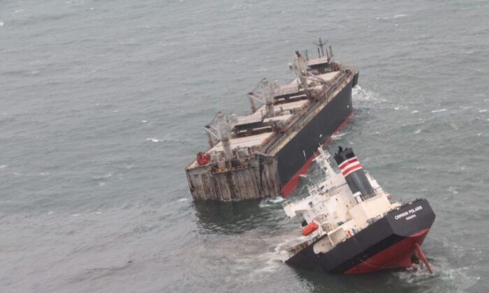 """A view of the Panamanian-registered ship """"Crimson Polaris"""" after it ran aground in Hachinohe harbor in Hachinohe, northern Japan on Aug. 12, 2021. (Courtesy of 2nd Regional Coast Guard Headquarters—Japan Coast Guard/Handout via Reuters)"""