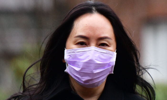 Huawei Chief Financial Officer, Meng Wanzhou, leaves her Vancouver home to attend British Columbia Supreme Court, in Vancouver, British Columbia, on January 12, 2021.  (Don MacKinnon / AFP via Getty Images)