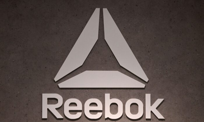 The logo of footwear and clothing company Reebok, a subsidiary of German sporting goods giant Adidas, is seen in a store in Munich, southern Germany, on March 10, 2021. (Christof Stache/AFP via Getty Images)