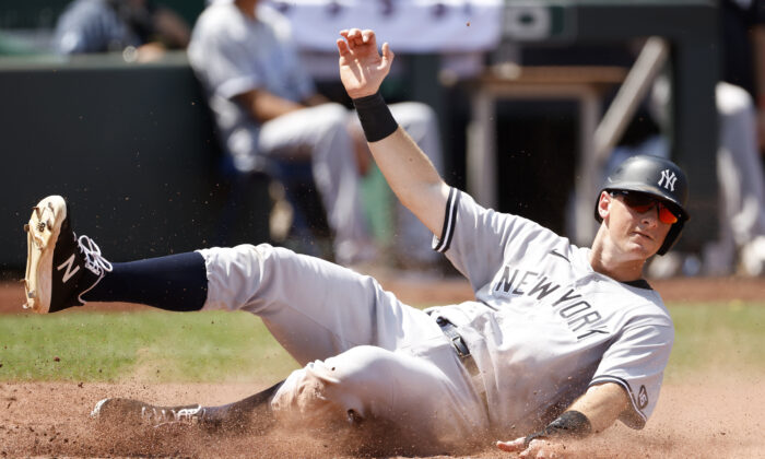 New York Yankees' DJ LeMahieu scores off an Aaron Judge single in the fourth inning of a baseball game against the Kansas City Royals at Kauffman Stadium in Kansas City, Mo., on Aug. 11, 2021. (Colin E. Braley/AP Photo)