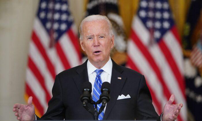 U.S. President Joe Biden speaks in the East Room of the White House in Washington, on Aug. 11, 2021. (Mandel Ngan/AFP via Getty Images)