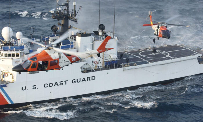 A Coast Guard maritime security force practices fast-roping to the Coast Guard cutter Seneca's flight deck eight miles south of Rockaway, New York, on Aug. 28, 2004. (Mike Hvozda/U.S. Coast Guard via Getty Images)