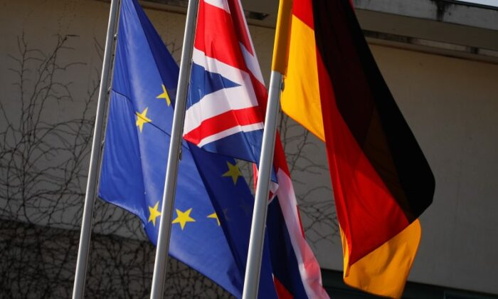 European Union, British and German flags flutter in front of a chancellery ahead of a visit of British Prime Minister Theresa May in Berlin, Germany, April 9, 2019. (Hannibal Hanschke/Reuters)