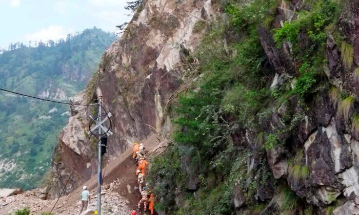 NDRF soldiers working on a rescue operation at the site of a landslide in Kinnaur district in the northern Indian state of Himachal Pradesh, India, on Aug. 11, 2021. (National Disaster Response Force via AP)