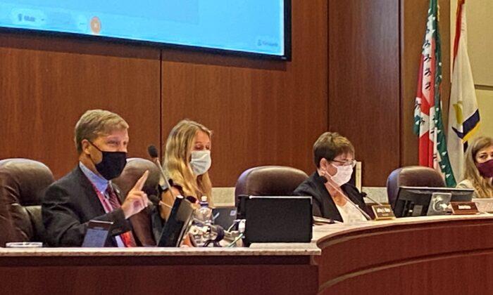 Loudoun County Public Schools board member Jeff Morse (L) speaks during a board meeting in Virginia on Aug. 11, 2021. (Terri Wu/The Epoch Times)