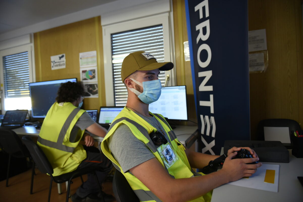 A staff member of European Union's border agency FRONTEX, operates an aerostat balloon system equipped with high tech surveillance cameras, in Alexandroupolis