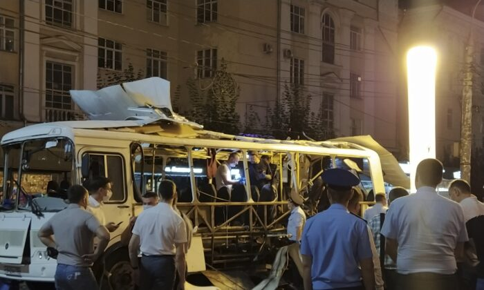 Police and investigators work at a site of an explosion on a city bus in Voronezh, Russia, on Aug. 12, 2021. (Kristina Brazhnikova/AP Photo)