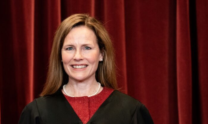 Associate Justice Amy Coney Barrett stands during a group photo of the Justices at the Supreme Court in Washington on April 23, 2021. (Erin Schaff/POOL/AFP via Getty Images)
