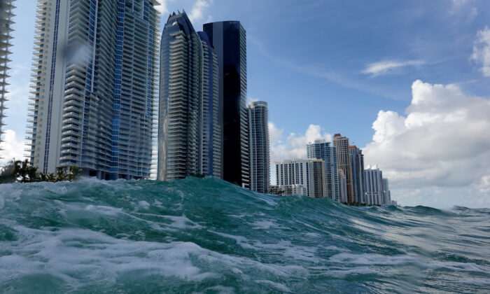 Waves lap ashore near condo buildings on the day the United Nations released a report with a dire warning for humanity, in Sunny Isles, Fla., on Aug, 9, 2021. (Joe Raedle/Getty Images)