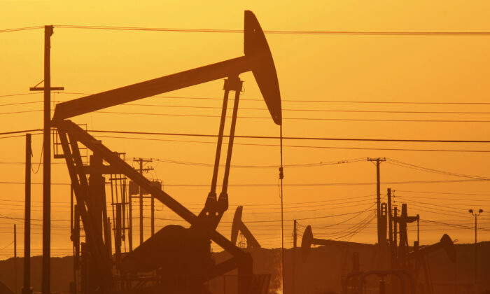Pump jacks are seen at dawn near Lost Hills, Calif., on March 24, 2014. (David McNew/Getty Images)