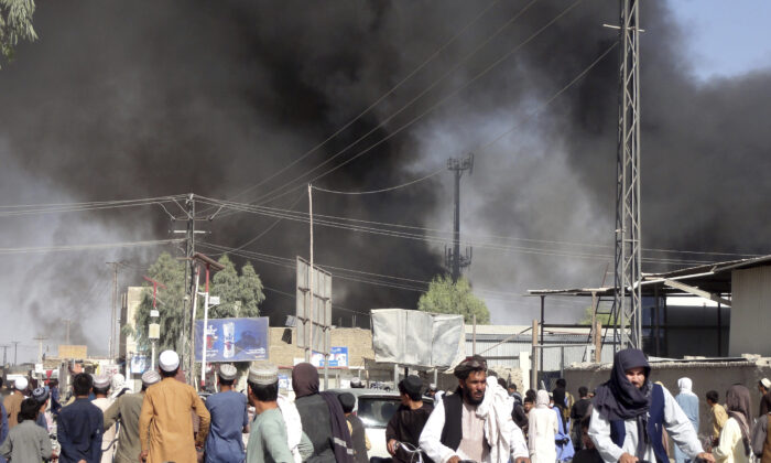 Smoke rises after fighting between the Taliban and Afghan security personnel in the city of Kandahar province south of Kabul, Afghanistan, on Aug. 12, 2021. (Sidiqullah Khan/AP Photo)