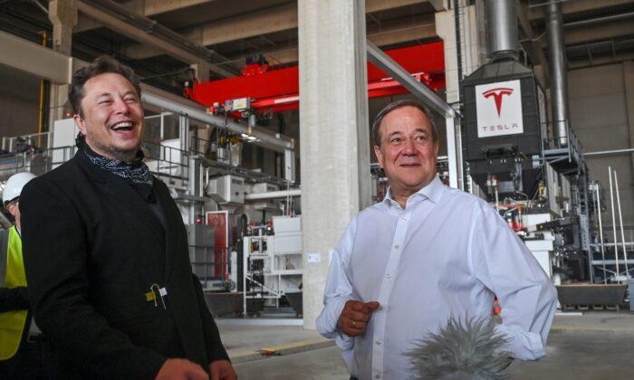 Tesla CEO Elon Musk and Christian Democratic Union (CDU) party leader Armin Laschet visit the construction site of Tesla's Gigafactory in Gruenheide near Berlin, Aug. 13, 2021. (Patrick Pleul/Pool via Reuters)