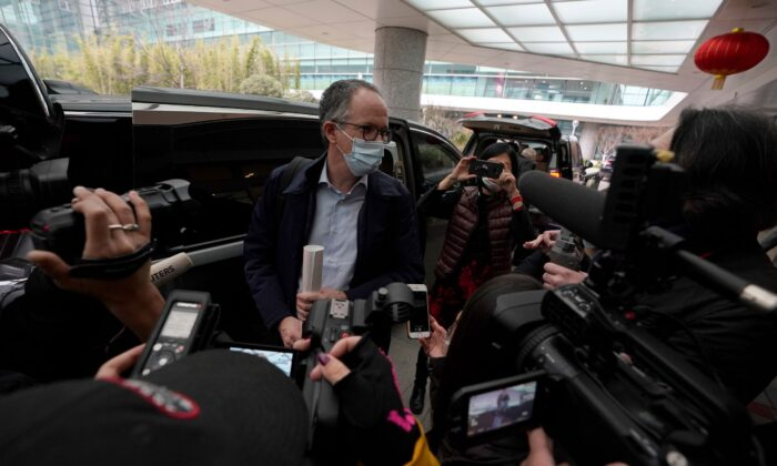 Peter Ben Embarek, of a World Health Organization team, speaks to journalists as he arrives at the airport  at the end of a WHO mission to investigate the origins of the coronavirus pandemic in Wuhan in China's Hubei province on Feb 10, 2021. (Ng Han Guan, File/AP Photo)