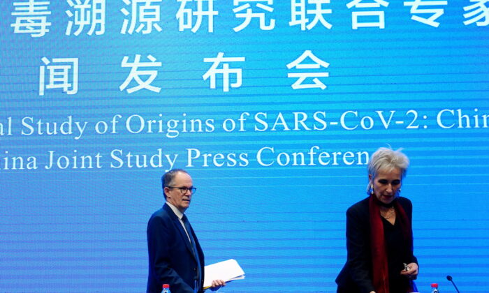 Peter Ben Embarek and Marion Koopmans, members of the WHO team arrive for the WHO-China joint study news conference at a hotel in Wuhan, Hubei province, China, on Feb. 9, 2021. (Aly Song/Reuters)