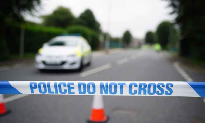 A police cordon is seen where six people, including the offender, died of gunshot wounds in a firearms incident in the Keyham area of Plymouth, England, on Aug. 13, 2021. (Ben Birchall/PA)