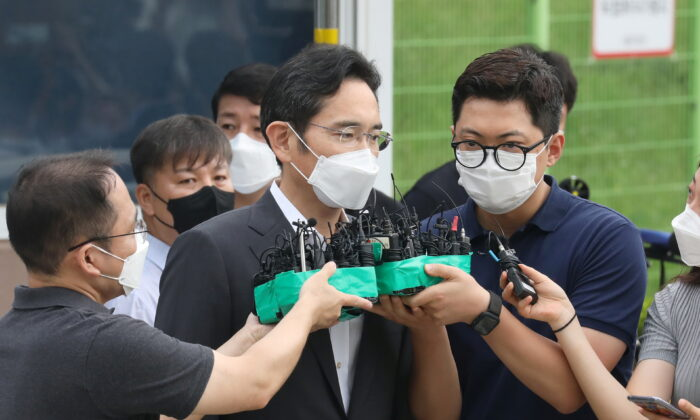Samsung Electronics vice chairman Jay Y. Lee speaks as he is released on parole from Seoul Detention Center in Uiwang, South Korea on Aug. 13, 2021. (Yonhap via Reuters)