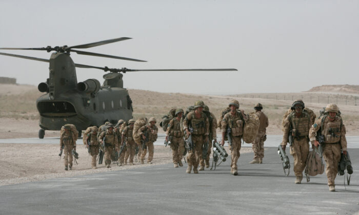 In this file image, British paratroopers from 3rd Battalion The Parachute Regiment arrive at Camp Eagle in the Zabul Province, Afghanistan, on June 17, 2008. (Marco Di Lauro/Getty Images)
