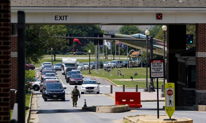 Security personnel stand at an entrance to Joint Base Anacostia-Bolling during a lockdown in Washington on Aug. 13, 2021. (Patrick Semansky/AP Photo)