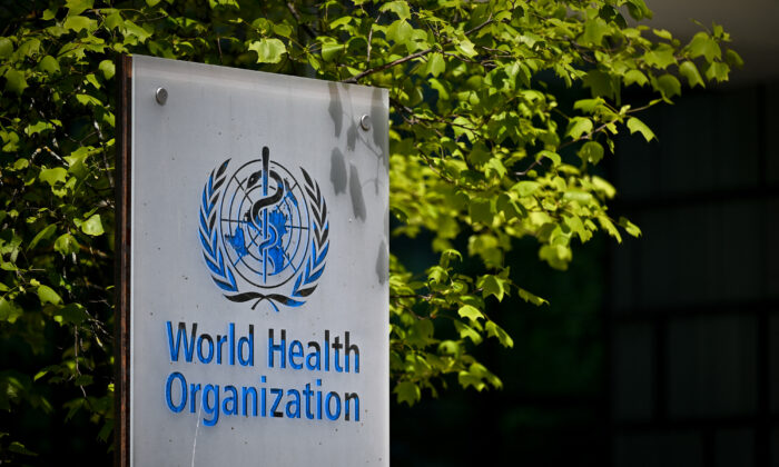 A sign of the World Health Organization (WHO) at the entrance of its headquarters in Geneva, on May 8, 2021. (Fabrice Coffrini/AFP via Getty Images)