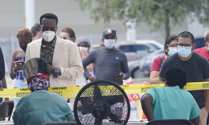 People line up to get tested for COVID-19 in North Miami, Fla., on Aug. 9, 2021. (Marta Lavandier/AP Photo)