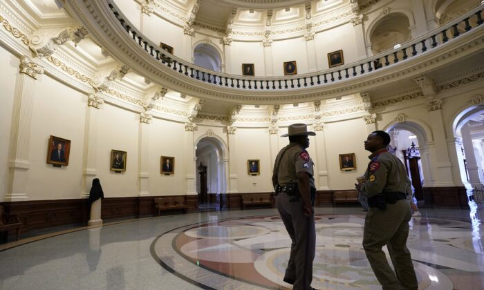 Texas Department of Safety officers stand watch over the Texas Capitol in Austin, Texas, on Aug. 11, 2021. (Eric Gay/AP Photo)