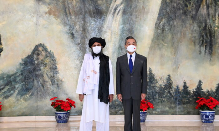 Chinese State Councilor and Foreign Minister Wang Yi meets with Mullah Abdul Ghani Baradar, political chief of Afghanistan's Taliban, in Tianjin, China on July 28, 2021.  (Li Ran/Xinhua via Reuters)