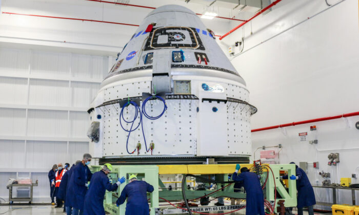 Technicians prepare Boeing's CST-100 Starliner for the company's Orbital Flight Test-2 (OFT-2) in the Commercial Crew and Cargo Processing Facility at NASA's Kennedy Space Center in Florida, on June 2, 2021. (NASA via AP)