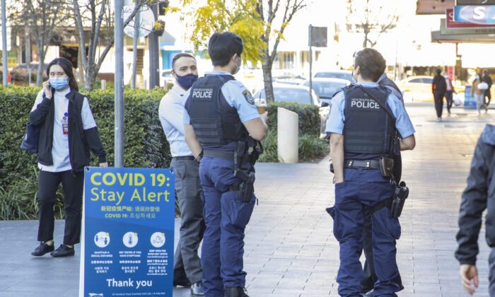 Police officers are seen at Strathfield shopping village  in Sydney, Australia, on Aug. 12, 2021. (Jenny Evans/Getty Images)