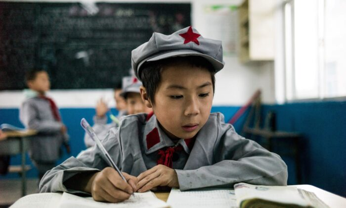 """Students study in their classroom at the Yang Dezhi """"Red Army"""" elementary school in Wenshui, Xishui county, Guizhou Province, on Nov. 7, 2016. (Fred Dufour/AFP via Getty Images)"""