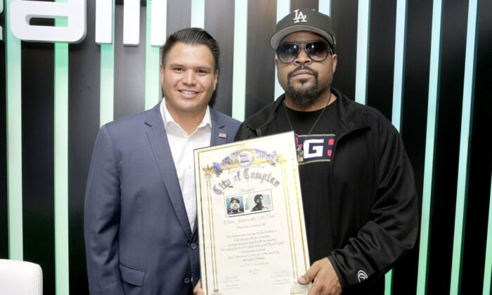 """Compton City Council member Isaac Galvan presents Ice Cube with a """"Celebration of Life"""" award from the City of Compton, in Los Angeles on June 14, 2018.  (Rachel Murray/Getty Images for Dream Hollywood)"""