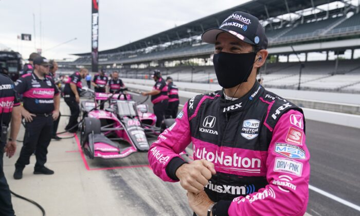 Helio Castroneves, of Brazil, waits in the pits before a practice session for a IndyCar auto race at Indianapolis Motor Speedway, in Indianapolis on Aug. 13, 2021. (Darron Cummings/AP Photo)