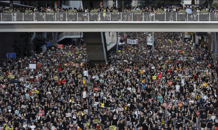 Protesters take part in a rally in Hong Kong on July 1, 2019. (Vincent Yu/AP Photo)