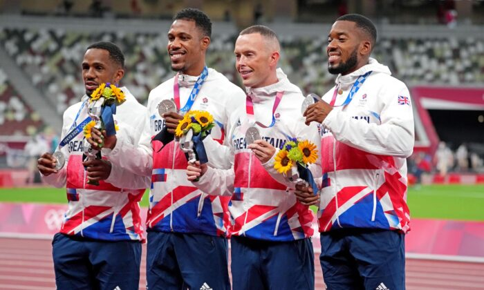 (L–R) Chijindu Ujah, Zharnel Hughes, Richard Kilty and Nethaneel Mitchell-Blake celebrate winning the silver medal in the men's 4x100 relay during the Tokyo 2020 Olympic Summer Games at the Olympic Stadium in Tokyo, Japan, on Aug 7, 2021. (Kirby Lee/USA TODAY Sports)