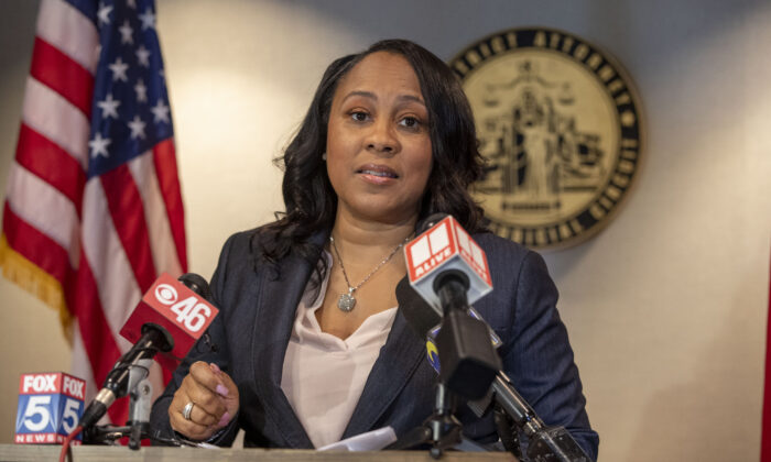 Fulton County District Attorney Fanni Willis speaks during a news conference at the Fulton County Courthouse in downtown Atlanta, on Aug. 13, 2021. (Alyssa Pointer/Atlanta Journal-Constitution via AP)