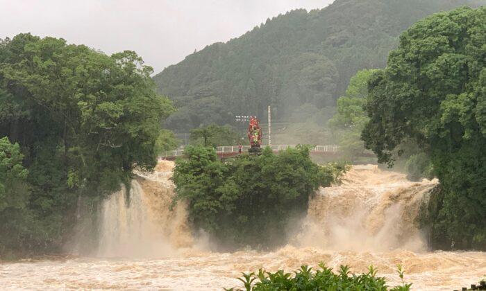 A general view shows muddy water during floods at Todorokinotaki water park in Ureshino city, Saga Prefecture, Japan, on Aug. 14, 2021. (Twitter @Konoemon321/via Reuters)
