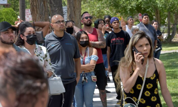 Family members wait to pick up students after a fatal shooting at Washington Middle School in Albuquerque, N.M., on Aug. 13, 2021. (Robert Browman/The Albuquerque Journal via AP)